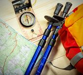 picture of south-pole  - compass map trekking poles and backpack on a wooden background - JPG