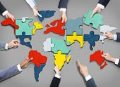 Corporate Business Team World Map Jigsaw Puzzle Concept