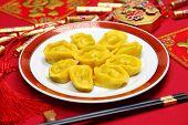 homemade chinese gold ingot dumplings, new year food, spring festival food