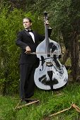 picture of double-bass  - man in tuxedo playing the double bass in park - JPG