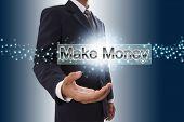 Businessman hand showing make money button