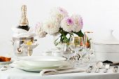 table with dishes and champagne on a white background