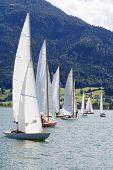 Sailing Ships In A Regatta On A Lake
