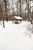 Snow Covered Wooden Pavilion In Urban Park
