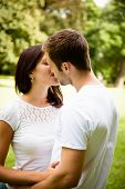 Young kissing couple in love