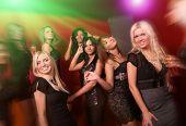 Image of pretty girls dancing in night club