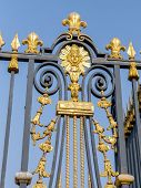 stock photo of versaille  - Front fence of Versailles Palace with golden ornaments - JPG