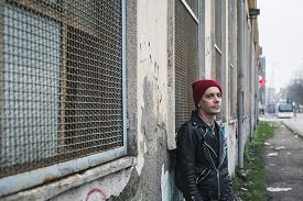 pic of anarchists  - Punk guy with beanie posing in the city streets - JPG