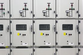 stock photo of substation  - Metal enclosed industrial electrical energy distribution substation - JPG