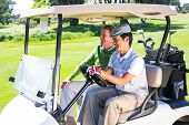 picture of buggy  - Golfing friends laughing together in their golf buggy at the golf course - JPG
