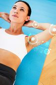 picture of crunch  - Determined young woman doing abdominal crunches against fitness interface - JPG