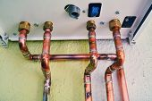 picture of gas-pipes  - copper pipes of a domestic gas boiler system - JPG