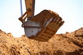 stock photo of excavator  - Close up view of a shovel of a excavator on a construction site - JPG