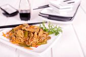 image of soya beans  - Thai dish of rice pasta mushrooms meat carrots green beans and soya sauce on a white plate - JPG