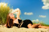 pic of sunbathing woman  - Summer vacation day freetime concept - JPG