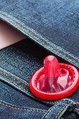 stock photo of condom use  - Contraception and birth control safe sex concept - JPG
