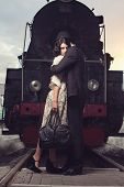 picture of locomotive  - parting of lovely couple on railway station at locomotive background - JPG