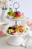 stock photo of cake stand  - Assorted cakes and pastries on a cake stand for afternoon tea - JPG