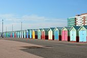 stock photo of beach hut  - Colourful beach huts on the promenade at Hove in Brighton East Sussex England - JPG
