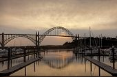picture of marina  - Yaquina bay bridge at sunset from the marina on the south side in Newport Oregon - JPG