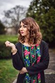 stock photo of ombres  - Retro style photo of fashion woman wearing elegant dress with printed floral pattern - JPG