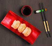 stock photo of siomai  - Vietnam style steamed shrimp dumplings served on a black background - JPG