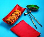stock photo of deep  - traditional Vietnam deep fried shrimp and pork rolls in breadcrumbs served on a blue background - JPG