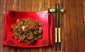 picture of stir fry  - Vietnamese beef stir fry served on a wood table top  - JPG