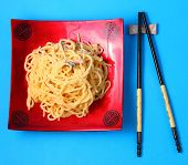 picture of carbonara  - spaghetti carbonara served on a blue blackground - JPG