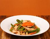 pic of stir fry  - chicken stir fry thai style on a brown background on a wood table - JPG