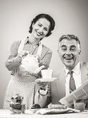 image of 1950s  - 1950s beautiful woman serving tea for breakfast to her smiling husband - JPG