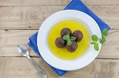 picture of gulab  - gulab jamun with syrup in a dish on a blue linen - JPG