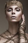 stock photo of pale  - Beautiful girl with a bronze skin - JPG
