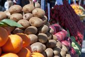 picture of stall  - Market stall with ripe fruits in the sun - JPG