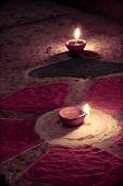 foto of rangoli  - oil lamp at center of colorful rangoli - JPG