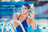 picture of goggles  - Portrait of a young woman in goggles and swimming cap - JPG