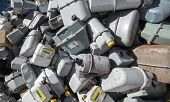 stock photo of landfills  - rusted old abandoned gas counters in waste landfill - JPG
