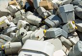 stock photo of landfills  - bunch of old gas meters in a contaneir of the landfill of hazardous material - JPG