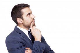 stock photo of thoughtfulness  - Thoughtful business man - JPG