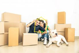 pic of dog-house  - Happy couple with dog moving to a new home  - JPG