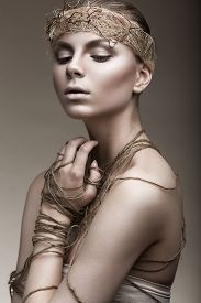 stock photo of pale skin  - Beautiful girl with a bronze skin - JPG
