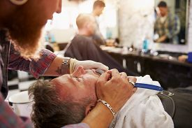 image of razor  - Barber Shaving Client With Cut Throat Razor - JPG