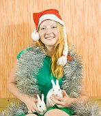 picture of tawdry  - teen girl in santa hat with two pet rabbits - JPG