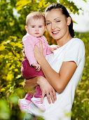 Happy Mather With Attractive Baby Outdoor