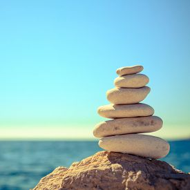 foto of stability  - Stones balance at the vintage beach inspirational summer landscape - JPG